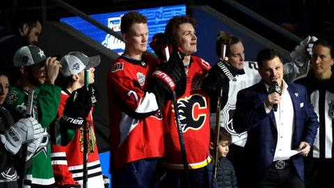 <p>               Ottawa Senators' Brady Tkachuk, left, and his brother Calgary Flames' Matthew Tkachuk watch the Skills Competition, part of the NHL All-Star weekend, Friday, Jan. 24, 2020, in St. Louis. (AP Photo/Jeff Roberson)             </p>