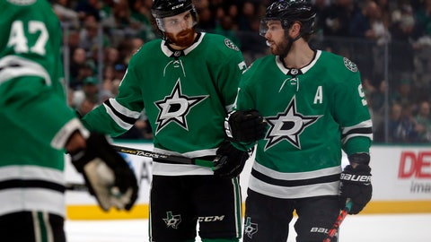 <p>               Dallas Stars defenseman Stephen Johns, left, talks with Dallas Stars center Tyler Seguin, right, during a break in the action in the second period of an NHL hockey game against the Tampa Bay Lightning in Dallas, Monday, Jan. 27, 2020. (AP Photo/Ray Carlin)             </p>