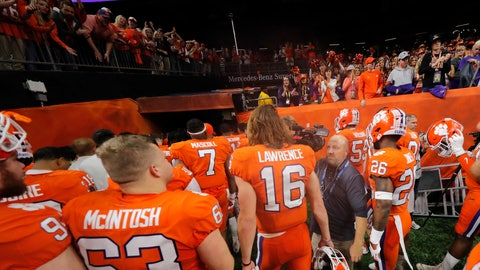 <p>               Clemson quarterback Trevor Lawrence (16) leaves the field after a NCAA College Football Playoff national championship game against LSU, Monday, Jan. 13, 2020, in New Orleans. LSU won 42-25. (AP Photo/Gerald Herbert)             </p>