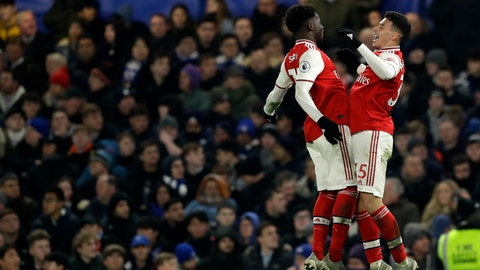 <p>               Arsenal's Gabriel Martinelli, right, celebrates with Arsenal's Bukayo Saka after scoring his side's opening goal during the English Premier League soccer match between Chelsea and Arsenal at Stamford Bridge Stadium in London, Tuesday, Jan. 21, 2020. (AP Photo/Matt Dunham)             </p>