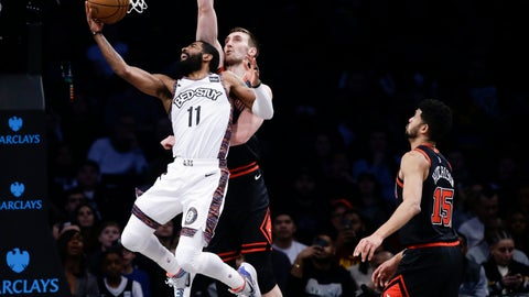 <p>               Brooklyn Nets' Kyrie Irving (11) drives past Chicago Bulls' Luke Kornet and Chandler Hutchison (15) during the first half of an NBA basketball game Friday, Jan. 31, 2020, in New York. (AP Photo/Frank Franklin II)             </p>