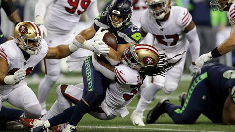 <p>               Seattle Seahawks running back Travis Homer (25) is brought down by San Francisco 49ers' Marcell Harris on a carry during the first half of an NFL football game, Sunday, Dec. 29, 2019, in Seattle. (AP Photo/Stephen Brashear)             </p>