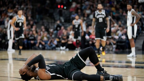<p>               Brooklyn Nets' David Nwaba lies injured on the court during the second half of the team's NBA basketball game against the San Antonio Spurs, Thursday, Dec. 19, 2019, in San Antonio. San Antonio won 118-105. (AP Photo/Darren Abate)             </p>
