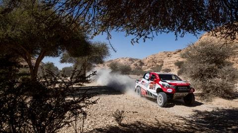 <p>               Driver Fernando Alonso, of Spain, and co-driver Marc Coma, of Spain, race their Toyotaduring stage nine of the Dakar Rally between Wadi Al Dawasir and Haradth, Saudi Arabia, Tuesday, Jan. 14, 2020. (AP Photo/Bernat Armangue)             </p>