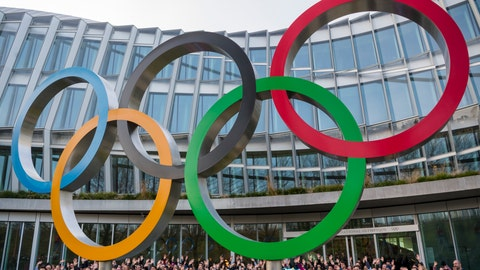 <p>               Young people pose behind the Olympic Rings during the Torch Tour ahead of the 2020 Winter Youth Olympic Games, front of the Olympic House, in Lausanne, Switzerland, Wednesday, Jan. 8, 2020. The 2020 Winter Youth Olympic Games take place in Lausanne from Jan. 9 to Jan. 22, 2020. (Jean-Christophe Bott/Keystone via AP)             </p>