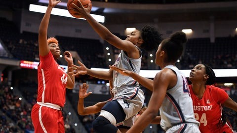 <p>               Connecticut's Christyn Williams, center, goes up for a basket as Houston's Jazmaine Lewis, left, and Houston's Maya Jones, right, defend, in the second half of an NCAA college basketball game, Saturday, Jan. 11, 2020, in Hartford, Conn. (AP Photo/Jessica Hill)             </p>