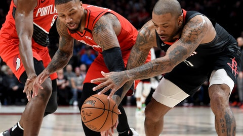 <p>               Portland Trail Blazers guard Damian Lillard, left, and Houston Rockets forward P.J. Tucker, right, go after a loose ball during the first half of an NBA basketball game in Portland, Ore., Wednesday, Jan. 29, 2020. (AP Photo/Steve Dykes)             </p>