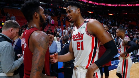 <p>               Portland Trail Blazers center Hassan Whiteside (21) and Miami Heat forward Derrick Jones Jr. (5) talk after an NBA basketball game, Sunday, Jan. 5, 2020, in Miami. The Heat defeated the Trail Blazers 122-111. (AP Photo/Wilfredo Lee)             </p>