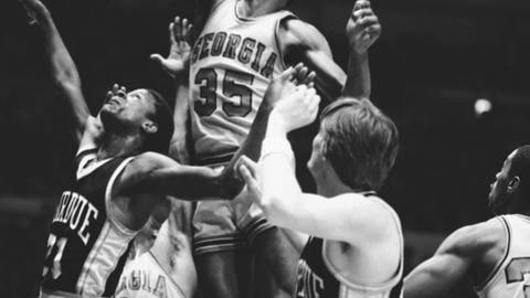 <p>               In this March 22, 1982, file photo, Georgia's Terry Fair (35) goes up with the ball with Purdue's Ricky Hall, left, and teammate Dan Palombizio, right, in close range during the first half of a semifinal game in the National Invitation Tournament at New York's Madison Square Garden. Fair, a key player on Georgia only men's Final Four team, has died at the age of 59, the school announced, Friday, Jan. 31, 2020. The university said Fair died Thursday of natural causes in his hometown of Macon, Ga. (AP Photo/Richard Drew, File)             </p>