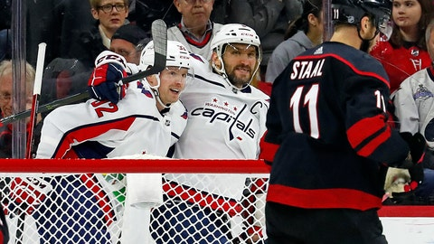 <p>               Washington Capitals' Evgeny Kuznetsov (92), of Russia, is congratulated on his goal by teammate Alex Ovechkin (8), of Russia, with Carolina Hurricanes' Jordan Staal (11) nearby during the second period of an NHL hockey game in Raleigh, N.C., Friday, Jan. 3, 2020. (AP Photo/Karl B DeBlaker)             </p>