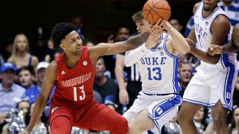 <p>               Louisville guard David Johnson (13) reaches for the ball while Duke forward Joey Baker (13) looks to pass it during the first half of an NCAA college basketball game in Durham, N.C., Saturday, Jan. 18, 2020. (AP Photo/Gerry Broome)             </p>