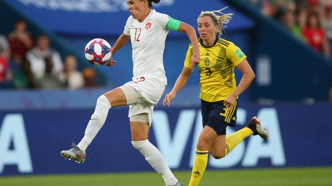 <p>               FILE - In this June 24, 2019, file photo, Canada's Christine Sinclair, left, is chased down by Sweden's Linda Sembrant during a Women's World Cup round of 16 soccer match in Paris, France. Sinclair highlights Canada's 20-player roster for the CONCACAF Olympic qualifying tournament starting later this month. Sinclair is one goal away from tying retired U.S. star Abby Wambach's record of 184 goals in international play. (AP Photo/Francisco Seco, File)             </p>