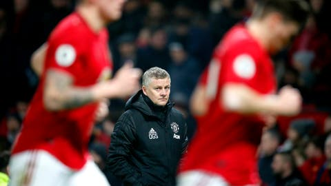 <p>               Manchester United manager Ole Gunnar Solskjaer, centre, watches the action from the touchline, during the English Premier League soccer match between Manchester United and Burnley, at Old Trafford, in Manchester, England, Wednesday, Jan. 22, 2020. (Martin Rickett/PA via AP)             </p>