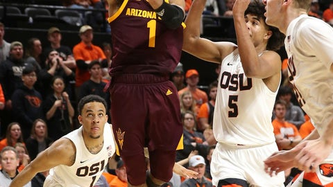 <p>               Arizona State's Remy Martin, center, shoots between against Oregon State's Sean Miller-Moore, left, Ethan Thompson, center right, and Kylor Kelley, right, during the second half of an NCAA college basketball game in Corvallis, Ore., Thursday, Jan. 9, 2020. (AP Photo/Chris Pietsch)             </p>