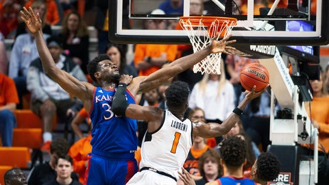 <p>               Oklahoma State guard Jonathan Laurent (1) leans on Kansas center Udoka Azubuike (35) while taking a shot during the second half of an NCAA college basketball game in Stillwater, Okla., Monday, Jan. 27, 2020. Kansas defeated Oklahoma State 65-50. (AP Photo/Brody Schmidt)             </p>