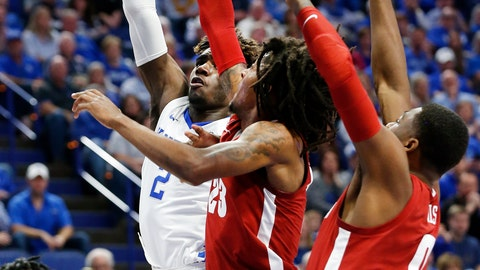 <p>               Kentucky's Kahlil Whitney, left, shoots while pressured by Alabama's John Petty Jr. and Javian Davis, right, during the first half of an NCAA college basketball game in Lexington, Ky., Saturday, Jan 11, 2020. (AP Photo/James Crisp)             </p>