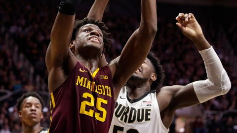 <p>               Minnesota center Daniel Oturu (25) shoots in front of Purdue forward Trevion Williams (50) during the first half of an NCAA college basketball game in West Lafayette, Ind., Thursday, Jan. 2, 2020. (AP Photo/Michael Conroy)             </p>