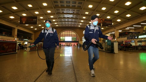 <p>               Workers spray disinfectant at a train station in Wuhan in southern China's Hubei province, Wednesday, Jan. 22, 2020. Chinese health authorities urged people in the city of Wuhan to avoid crowds and public gatherings, after warning on Wednesday that a new viral illness that has infected hundreds and caused at least nine deaths could spread further. (Chinatopix via AP)             </p>