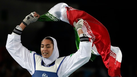 """<p>               FILE - In this Aug. 18, 2016 file photo, Kimia Alizadeh Zenoorin of Iran celebrates after winning the bronze medal in a women's Taekwondo 57-kg competition at the 2016 Summer Olympics in Rio de Janeiro, Brazil. Zenoorin, Iran's only female Olympic medalist, said she defected from the Islamic Republic in a blistering online letter that describes herself as """"one of the millions of oppressed women in Iran."""" (AP Photo/Andrew Medichini, File)             </p>"""