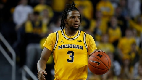 <p>               Michigan guard Zavier Simpson plays against Penn State in the second half of an NCAA college basketball game in Ann Arbor, Mich., Wednesday, Jan. 22, 2020. (AP Photo/Paul Sancya)             </p>