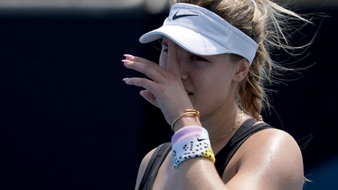 <p>               Canada's Eugenie Bouchard wipes the sweat from her face during her women's singles qualifying match against Italy's Martina Trevisan for the Australian Open tennis championship in Melbourne, Australia, Friday, Jan. 17, 2020. (AP Photo/Lee Jin-man)             </p>