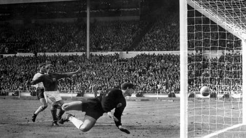 <p>               FILE - The July 30, 1966 file photo shows England's controversial third goal scored by Geoff Hurst (not in photo) past German goalkeeper Hans Tilkowski in the World Cup Final soccer match at London's Wembley Stadium. Hans Tilkowski, the West Germany goalkeeper in the 1966 World Cup final against England, has died. He was 84. (AP Photo, File)             </p>