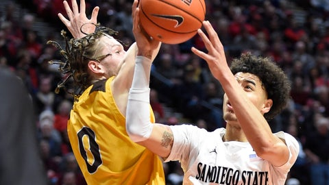 <p>               San Diego State guard Trey Pulliam (4) shoots past Wyoming guard Jake Hendricks (0) during the first half of an NCAA college basketball game Tuesday, Jan. 21, 2020, in San Diego. (AP Photo/Denis Poroy)             </p>