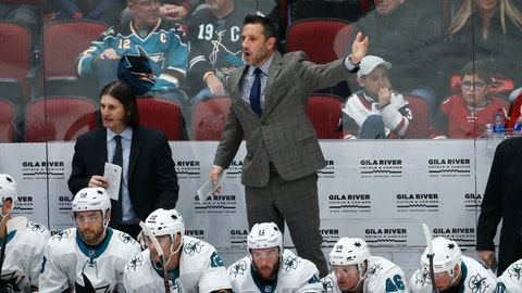 <p>               San Jose Sharks interim head coach Bob Boughner, middle, stands on the bench to wave his goalie off the ice as assistant coach Mike Ricci, back left, looks at the action on the ice during the third period of an NHL hockey game against the Arizona Coyotes Tuesday, Jan. 14, 2020, in Glendale, Ariz. The Coyotes defeated the Sharks 6-3. (AP Photo/Ross D. Franklin)             </p>
