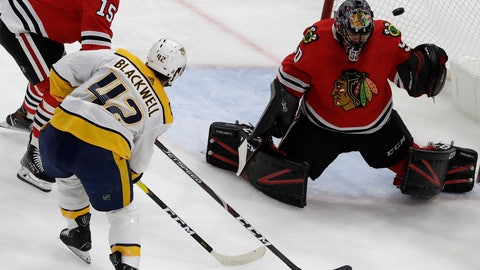 <p>               Chicago Blackhawks goalie Corey Crawford, right, cannot make the stop on a goal by Nashville Predators center Colin Blackwell (42) during the first period of an NHL hockey game in Chicago, Thursday, Jan. 9, 2020. (AP Photo/Nam Y. Huh)             </p>