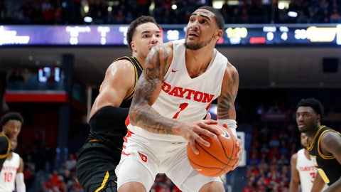 <p>               Dayton's Obi Toppin (1) eyes the basket against Virginia Commonwealth's Marcus Santos-Silva, left, during the first half of an NCAA college basketball game, Tuesday, Jan. 14, 2020, in Dayton, Ohio. (AP Photo/John Minchillo)             </p>