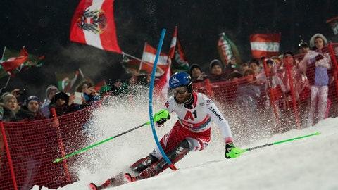 <p>               Austria's Marco Schwarz speeds down the course during an alpine ski, men's World Cup slalom, in Schladming, Austria, Tuesday, Jan. 28, 2020. (AP Photo/Giovanni Auletta)             </p>