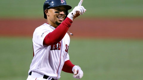 <p>               FILE - In this April 30, 2019, file photo, Boston Red Sox's Mookie Betts smiles as he crosses home plate on his solo home run off Oakland Athletics starting pitcher Aaron Brooks in the first inning of a baseball game at Fenway Park in Boston. Betts and the Red Sox agreed Friday, Jan. 10, 2020, to a $27 million contract, the largest one-year salary for an arbitration-eligible player. (AP Photo/Charles Krupa, File)             </p>