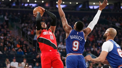 <p>               New York Knicks guard RJ Barrett (9) defends as Portland Trail Blazers forward Carmelo Anthony (00) shoots during the first half of an NBA basketball game in New York, Wednesday, Jan. 1, 2020. (AP Photo/Kathy Willens)             </p>