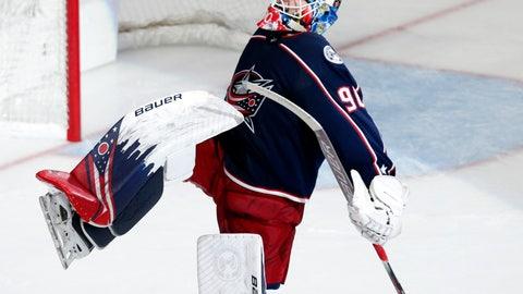<p>               Columbus Blue Jackets goalie Elvis Merzlikins, of Latvia, celebrates the Blue Jackets' 5-0 NHL hockey game win over the New Jersey Devils in Columbus, Ohio, Saturday, Jan. 18, 2020. (AP Photo/Paul Vernon)             </p>