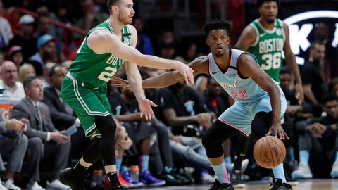 <p>               Boston Celtics forward Gordon Hayward, left, passes as Miami Heat forward Jimmy Butler (22) defends during the first half of an NBA basketball game, Tuesday, Jan. 28, 2020, in Miami. (AP Photo/Lynne Sladky)             </p>