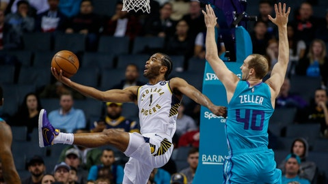 <p>               Indiana Pacers forward T.J. Warren, left, shoots a scoop shot as he drives past Charlotte Hornets forward Cody Zeller in the first half of an NBA basketball game in Charlotte, N.C., Monday, Jan. 6, 2020. (AP Photo/Nell Redmond)             </p>