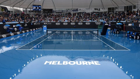 <p>               Spectators wait as rain stops plays during a first round singles match at the Australian Open tennis championship in Melbourne, Australia, Monday, Jan. 20, 2020. (AP Photo/Andy Brownbill)             </p>