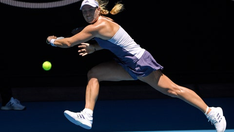 <p>               Germany's Angelique Kerber makes a backhand return to Italy's Camila Giorgi during their third round singles match at the Australian Open tennis championship in Melbourne, Australia, Saturday, Jan. 25, 2020. (AP Photo/Andy Brownbill)             </p>