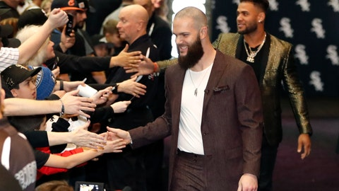 <p>               Chicago White Sox's Dallas Keuchel, center, is welcomed by fans after he was introduced during the team's annual fan convention Friday, Jan. 24, 2020, in Chicago. (AP Photo/Charles Rex Arbogast)             </p>
