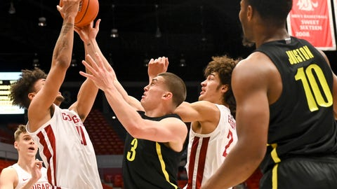<p>               Washington State forward DJ Rodman (11) pulls down a rebound away from Oregon guard Payton Pritchard (3) as forward CJ Elleby (2) watches during the first half of an NCAA college basketball game, Thursday, Jan. 16, 2020, in Pullman, Wash. (AP Photo/Pete Caster)             </p>
