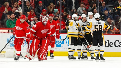 <p>               Pittsburgh Penguins center Sidney Crosby, third from right, celebrates his winning goal against the Detroit Red Wings in overtime of an NHL hockey game Friday, Jan. 17, 2020, in Detroit. (AP Photo/Paul Sancya)             </p>