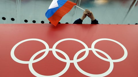 <p>               FILE - In this Feb. 18, 2014, file photo, a Russian skating fan holds the country's national flag over the Olympic rings before the start of the men's 10,000-meter speedskating race at Adler Arena Skating Center during the 2014 Winter Olympics in Sochi, Russia. The World Anti-Doping Agency banned Russia on Monday Dec. 9, 2019 from the Olympics and other major sporting events for four years, though many athletes will likely be allowed to compete as neutral athletes. (AP Photo/David J. Phillip, File)             </p>