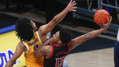 <p>               Louisville's David Johnson (13) goes to the basket at Pittsburgh's Justin Champagnie defends during the second half of an NCAA college basketball game Tuesday, Jan. 14, 2020, in Pittsburgh. Johnson missed the dunk. (AP Photo/Keith Srakocic)             </p>