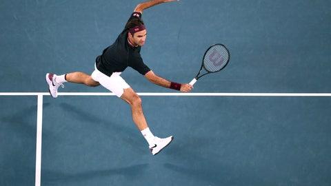 <p>               Switzerland's Roger Federer makes a backhand return to Australia's John Millman during their third round singles match at the Australian Open tennis championship in Melbourne, Australia, Friday, Jan. 24, 2020. (AP Photo/Dita Alangkara)             </p>