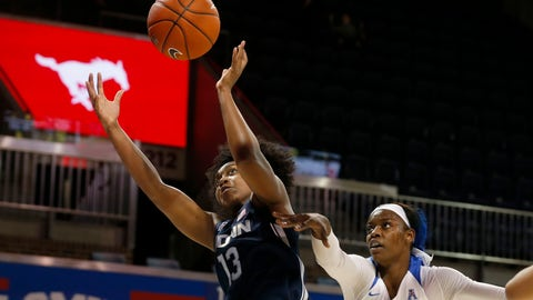 <p>               Connecticut guard Christyn Williams (13) tries to get a rebound as she is defended by SMU forward Johnasia Cash (33) during the first half of an NCAA college basketball game in University Park, Texas, Sunday, Jan. 5, 2020. (AP Photo/Michael Ainsworth)             </p>
