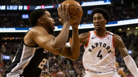 <p>               San Antonio Spurs' Rudy Gay, left, looks to make a play against Toronto Raptors' Rondae Hollis-Jefferson during first-half NBA basketball game action in Toronto, Sunday, Jan. 12, 2020. (Chris Young/The Canadian Press via AP)             </p>