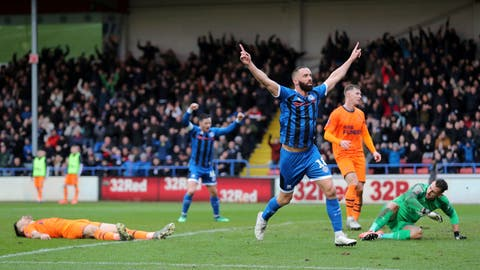 <p>               Rochdale's Aaron Wilbraham celebrates scoring his side's first goal of the game during the English FA Cup third round soccer match between Rochdale and Newcastle United at The Crown Oil Arena, Rochdale, England, Saturday, Jan. 4, 2020. Newcastle has been taken to a replay by third-tier Rochdale in the third round of the FA Cup to continue its poor recent record in the world's oldest club knockout competition. (Richard Sellers/PA via AP)             </p>