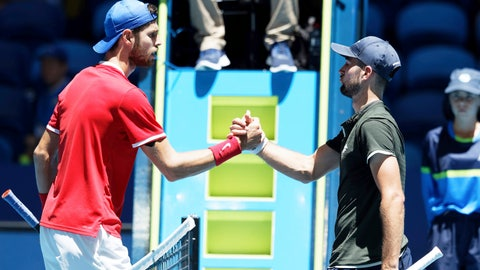 <p>               Russia's Karen Khachanov, left, shakes hands over the net with Norway's Viktor Durasovic after their ATP Cup tennis match in Perth, Australia, Tuesday, Jan. 7, 2020. (AP Photo/Trevor Collens)             </p>