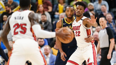<p>               Indiana Pacers forward T.J. Warren, center, defends Miami Heat forward Jimmy Butler (22) during the second half of an NBA basketball game in Indianapolis, Wednesday, Jan. 8, 2020. Warren was called for his second technical foul latter in the play. The Heat won 122-108. (AP Photo/AJ Mast)             </p>