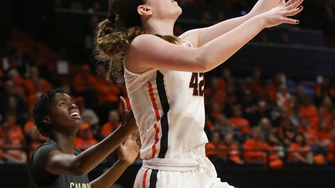 <p>               Oregon State's Kennedy Brown (42) drives to the basket past Colorado's Mya Hollingshed (21) during the first half of an NCAA college basketball game in Corvallis, Ore., Sunday, Jan. 5, 2020. (AP Photo/Amanda Loman)             </p>